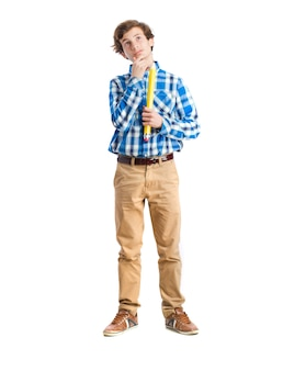 Teenager holding a pencil. toughtful gesture
