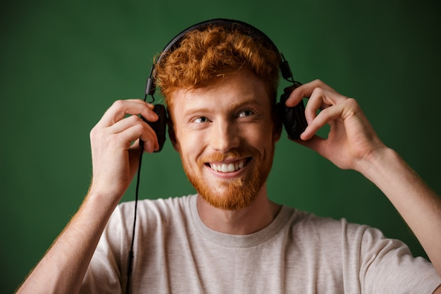 The teenager is enjoying listening to music,