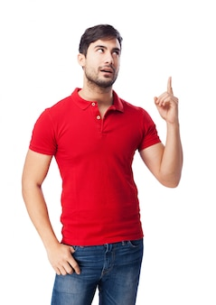 Teenager looking up with hand in pocket