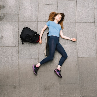 Teenager lying on ground