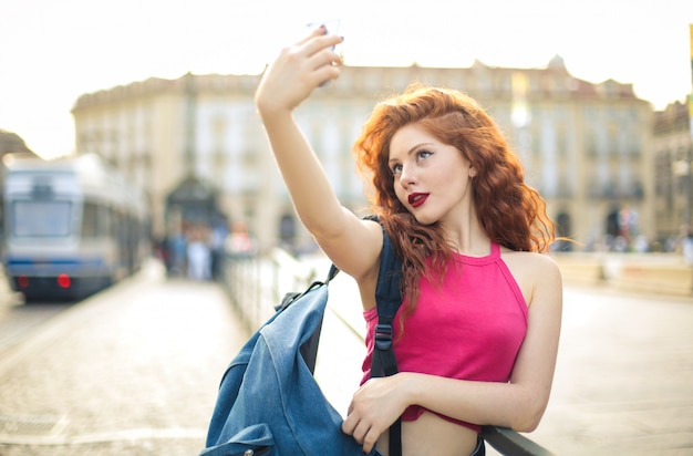 Teenager making a selfie with her phone