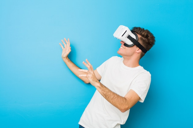 Teenager man using a virtual reality glasses
