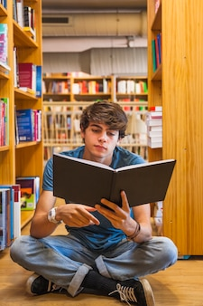 Teenager reading on floor