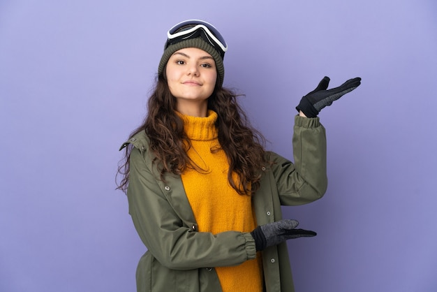 Teenager russian girl with snowboarding glasses isolated