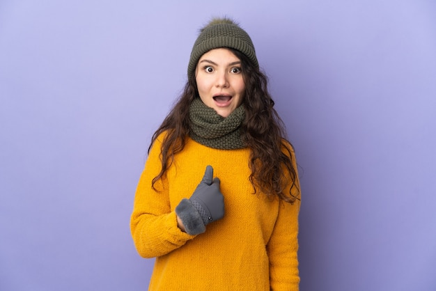 Teenager russian girl with winter hat isolated
