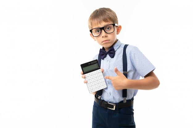 Teenager school boy shows 0 at calculator