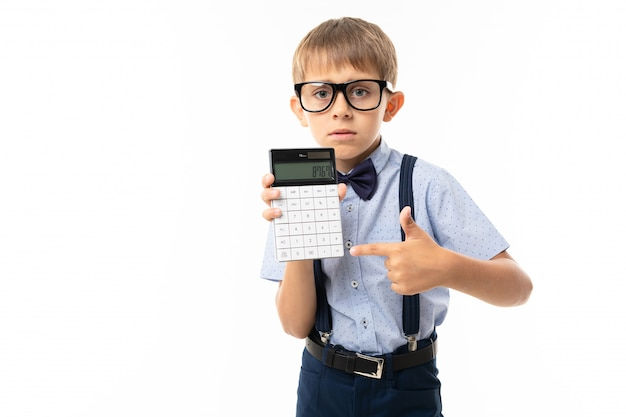 Teenager school boy shows a number at calculator, isolated