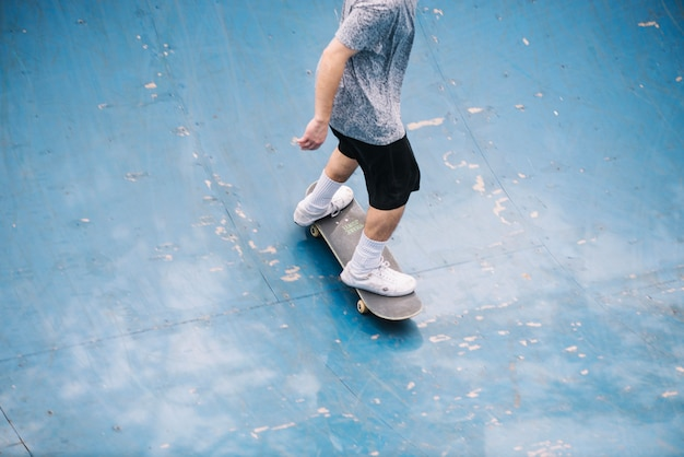 Teenager skating in bowl