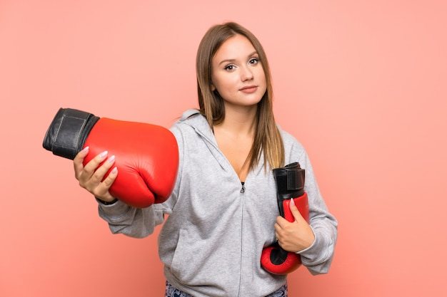 Teenager sport girl with boxing gloves