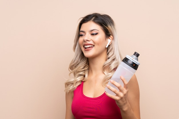 Teenager sport girl with sports water bottle