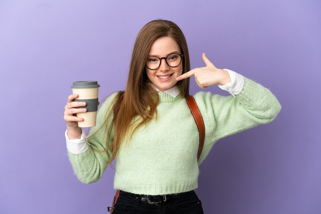 Teenager student girl over isolated purple background giving a thumbs up gesture