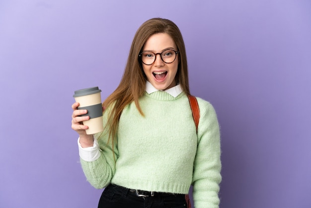 Teenager student girl over isolated purple background with surprise facial expression