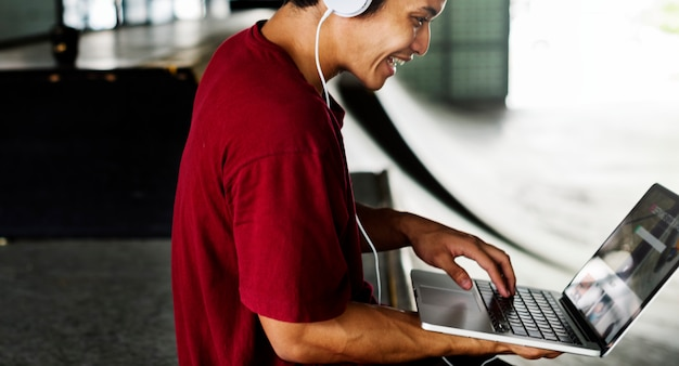 Teenager style listening music headphone street concept
