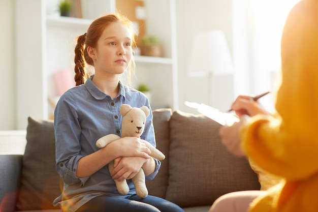 Teenager in therapy session