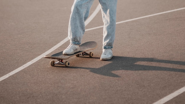 Teenager using skateboard outdoors