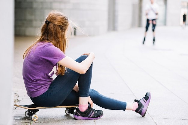 Teenager in violet t-shirt looking away