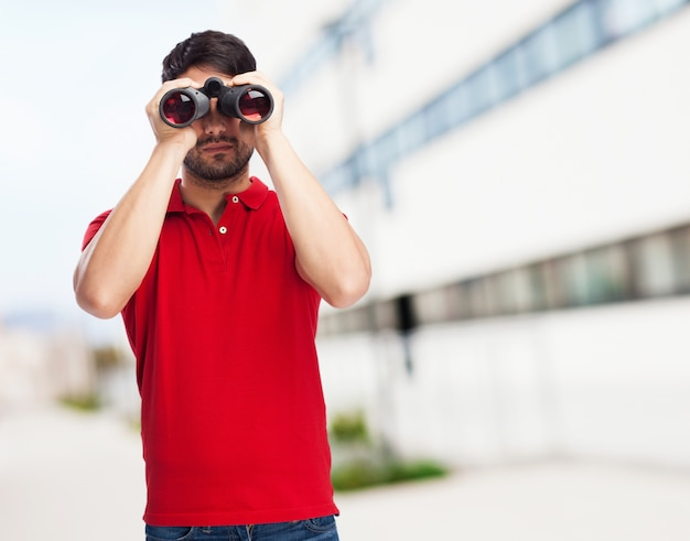 Teenager with red t-shirt and binoculars
