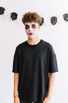 Teenager with scary grim and fangs