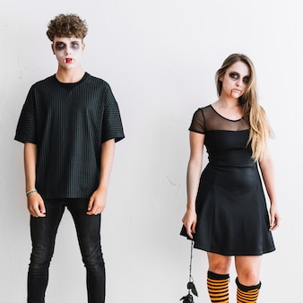 Teenagers in black clothes and frightening makeup