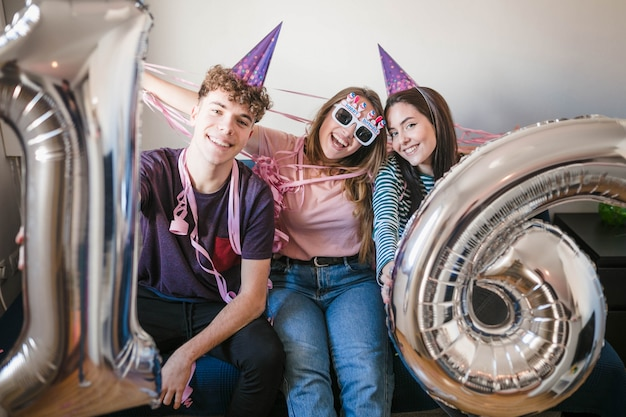 Teenagers celebrating birthday party