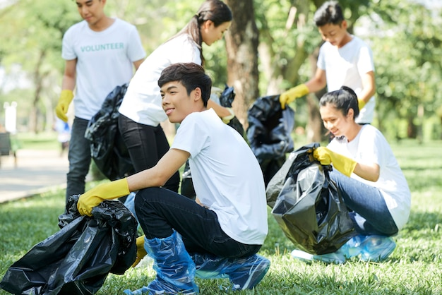 Teenagers clean the forest