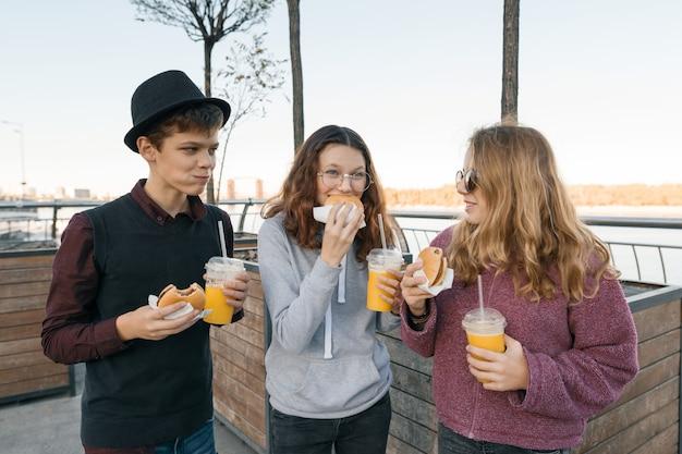 Teenagers eating street food