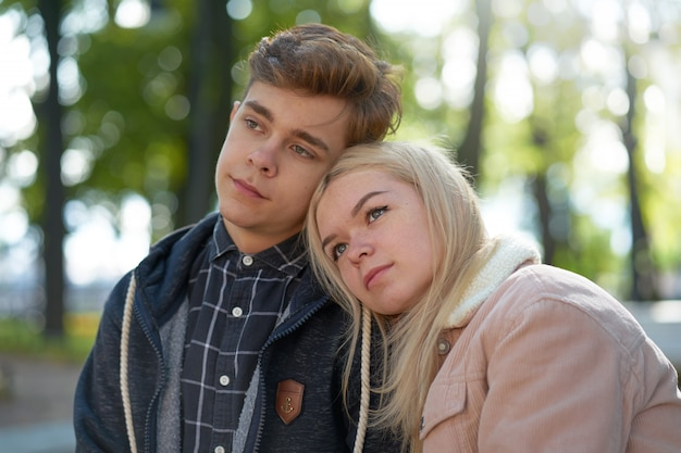 Teenagers in love dreaming in the rays of autumn sun. concept of teen love and happiness