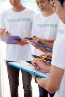Teenagers participating in volunteering