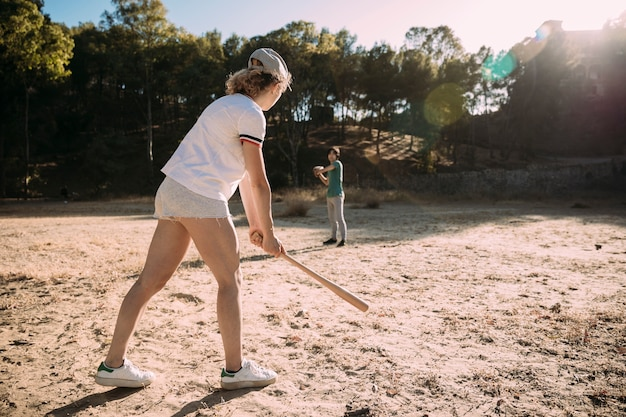 Teenagers playing baseball in park