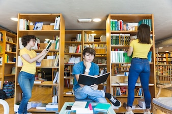 Teenagers spending time in library