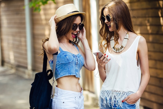 Teens with sunglasses listening to music together