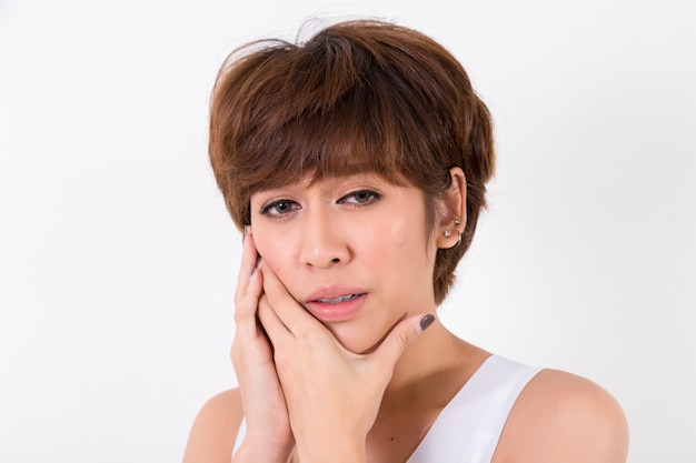 Teeth problem. woman feeling tooth pain.  isolated on white background. studio lighting. concept for healthy and medical