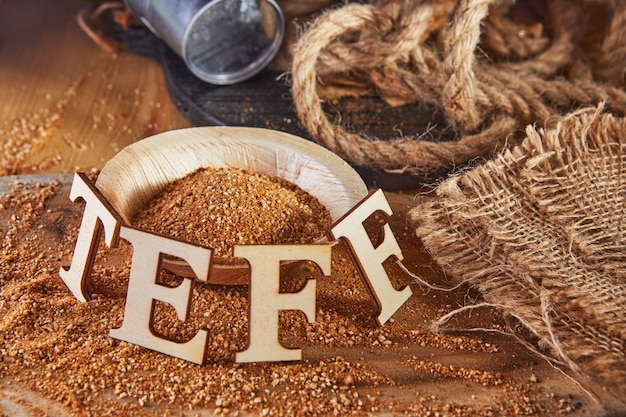 Teff, an alternative to ancient gluten-free grain with the name written in wooden letters.