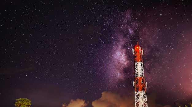 Telecom tower with galaxy milky way background
