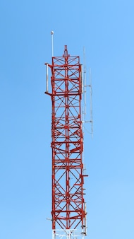Telecommunication tower closeup with red and white color.