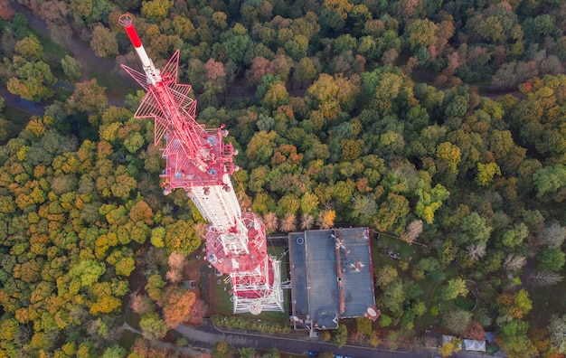 Telecommunication tower for mobile phone service and wireless 5g communication. against the background of the forest