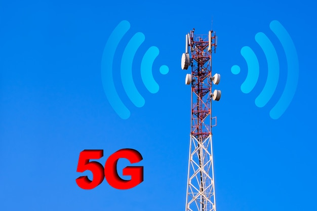 Telecommunication tower with 4g, 5g transmitters. cellular base station with transmitter antennas on a telecommunication tower on against a blue sky