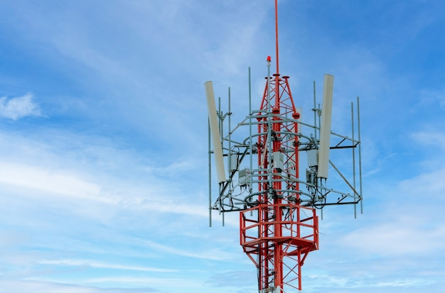 Telecommunication tower with blue sky and white clouds background antenna on blue sky