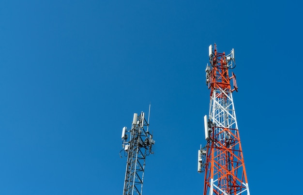 Telecommunication tower with clear blue sky. antenna on blue sky. radio and satellite pole. communication technology. telecommunication industry. mobile or telecom 4g network.
