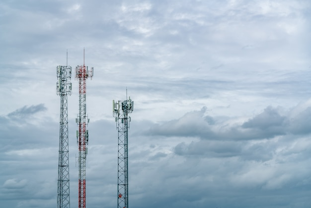 Telecommunication tower with white cloudy sky