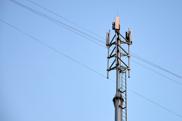 Telecommunications cell phone tower with mobile antennas on sky