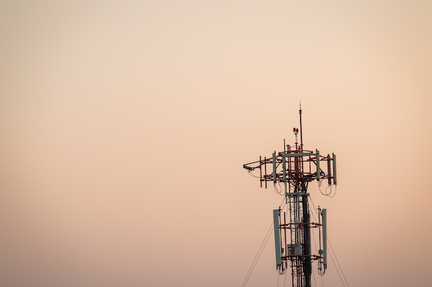 Telecommunications tower on sun set time