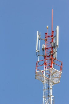 Telecommunications tower with blue sky