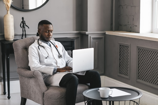 Telehealth with virtual doctor appointment and online therapy session. black doctor online conference .