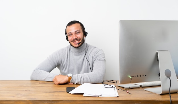 Telemarketer colombian man laughing
