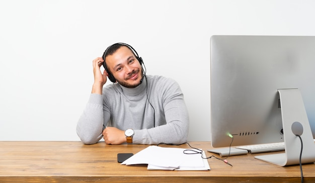 Telemarketer colombian man with an expression of frustration and not understanding