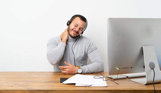 Telemarketer colombian man with neckache