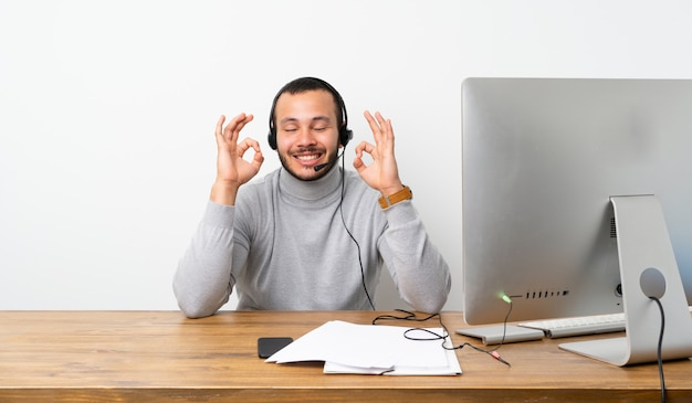 Telemarketer colombian man in zen pose