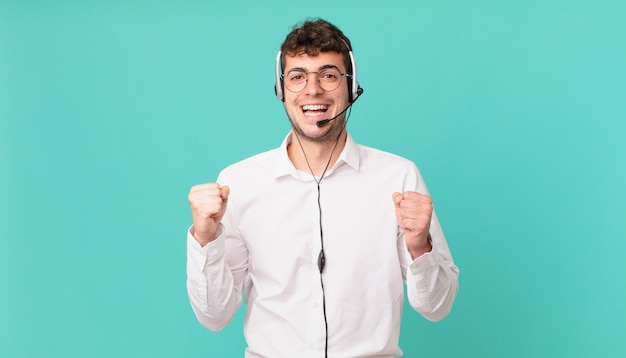 Telemarketer feeling shocked, excited and happy, laughing and celebrating success, saying wow!