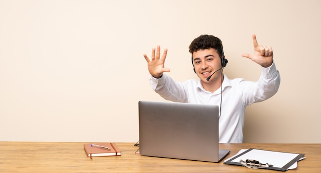 Telemarketer man counting seven with fingers